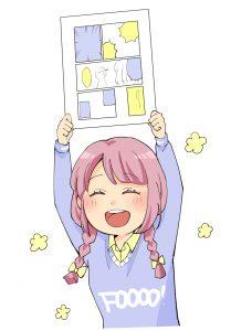 漫画を書き上げて喜ぶ少女